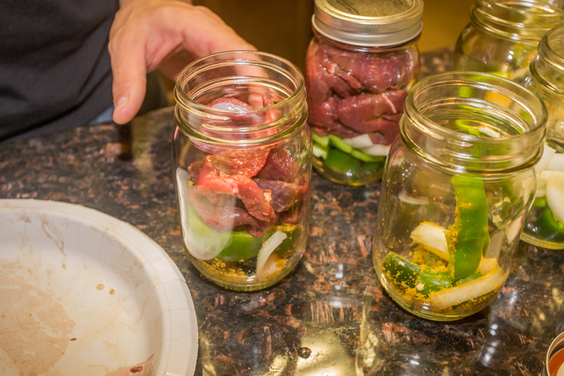 Filling jars with meat