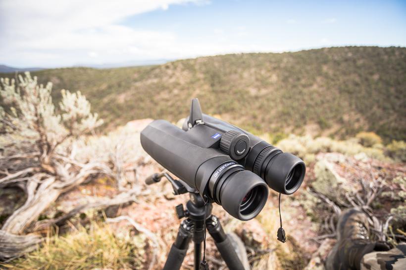 15x binoculars mounted to a tripod