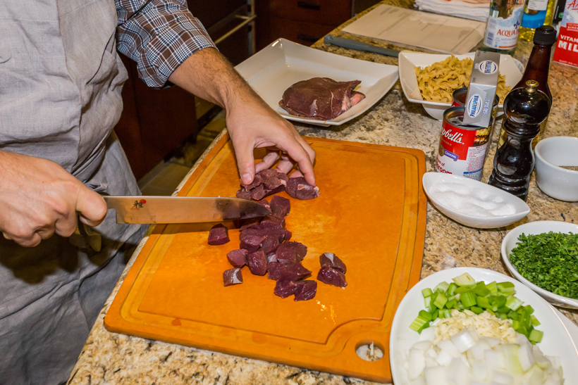Cutting up elk meat into cubes