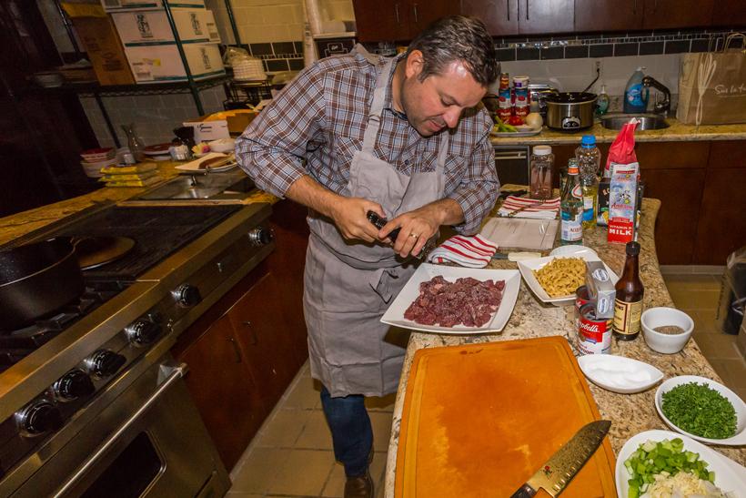 Adding seasoning to elk meat