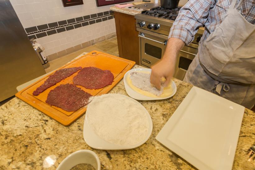 Adding floured elk meat to the batter