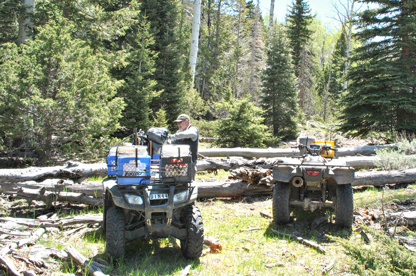 ATVs loaded with baiting supplies