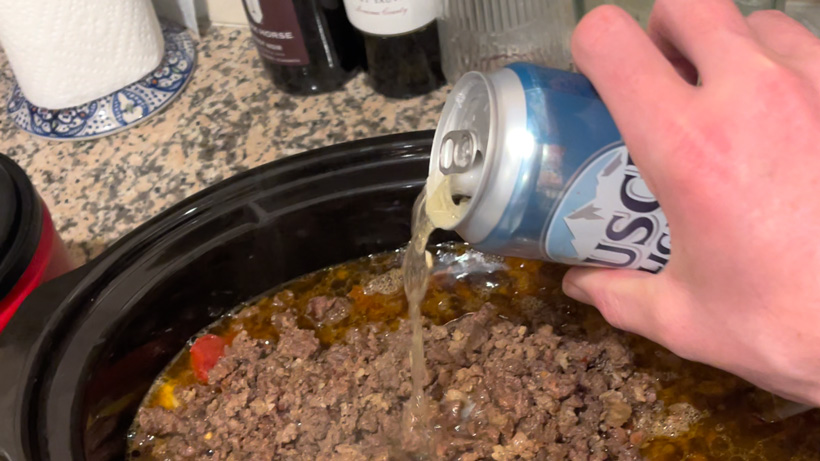 Adding Busch light to mule deer chili