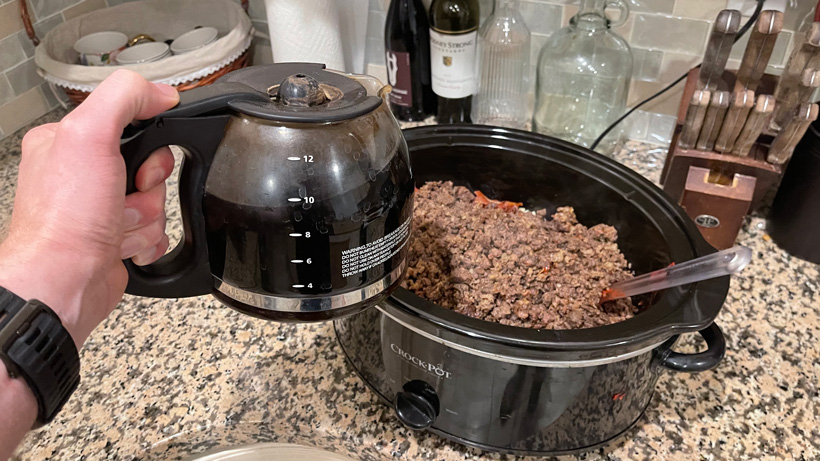 Adding black coffee to mule deer chili