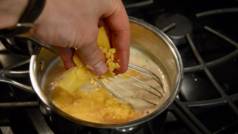Adding cheese to the pot