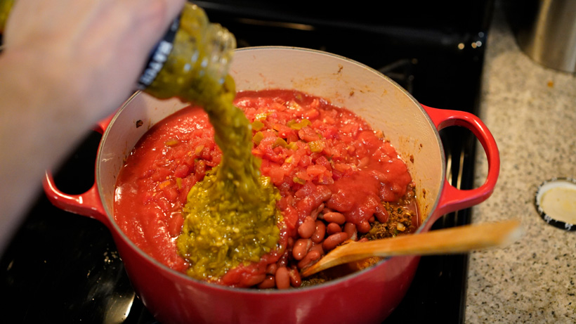 Adding green chile salsa