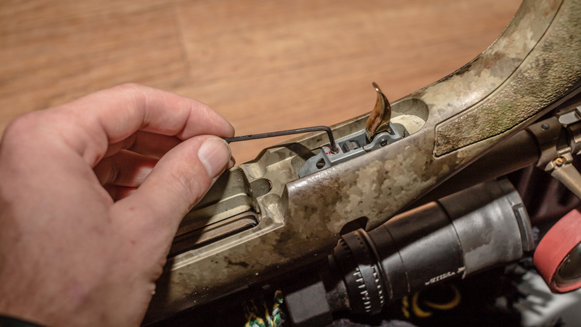 Adjusting a hunting rifle trigger tension screw