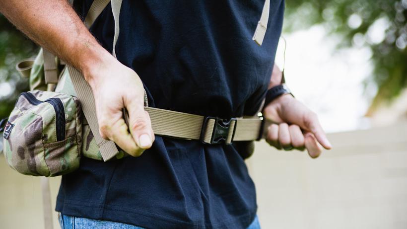 Adjusting the waist belt on a hunting backpack