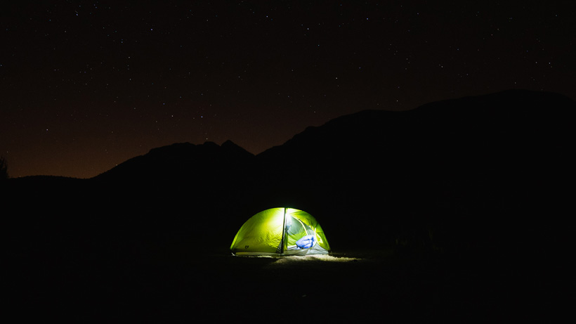 Backcountry campsite at night under the stars