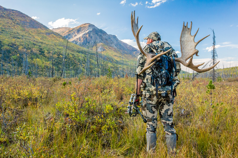 Brady Miller packing out an archery bull moose