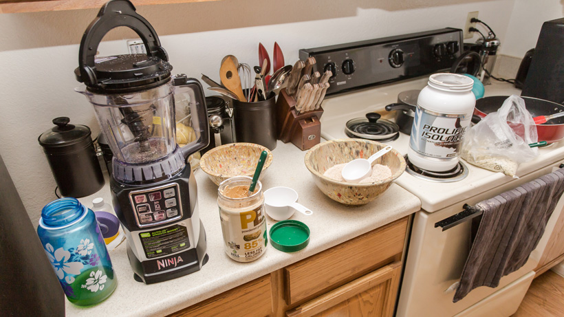 Brady Miller preparing protein shakes for backcountry hunting