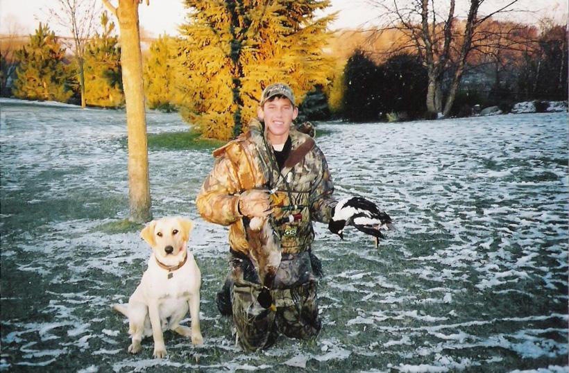 Brady Miller with his dog Drake