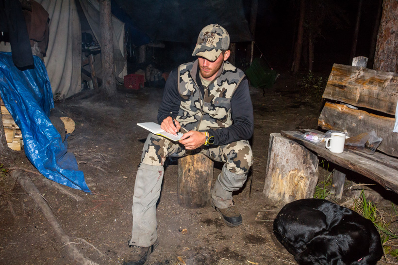 Brady writing in his hunting journal