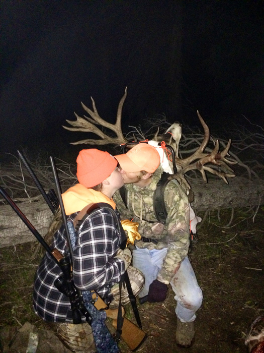 Brett Ross with his girlfriend and buck