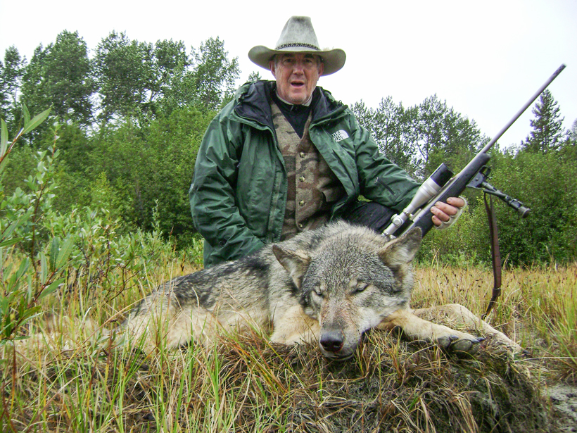 Bruce Hutcheon with his wolf