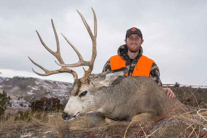 Bryce Miller with his Montana mule deer