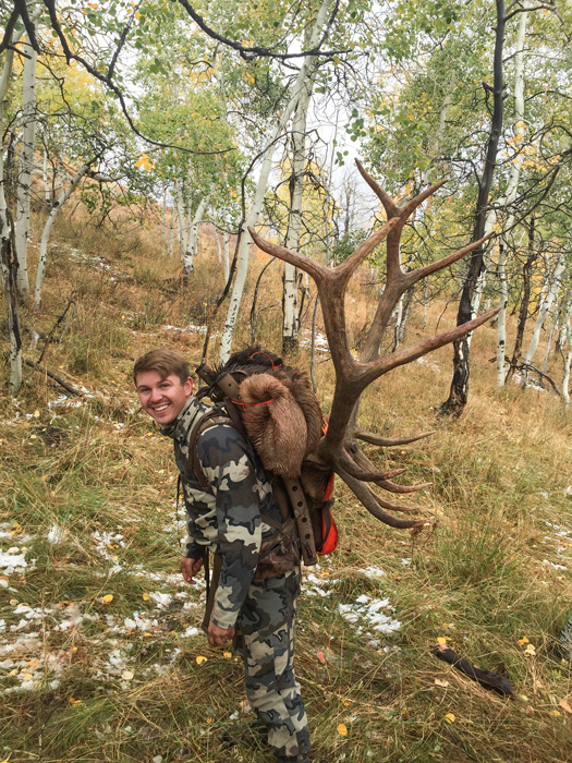 Bryton Mecham packing out his Utah bull elk