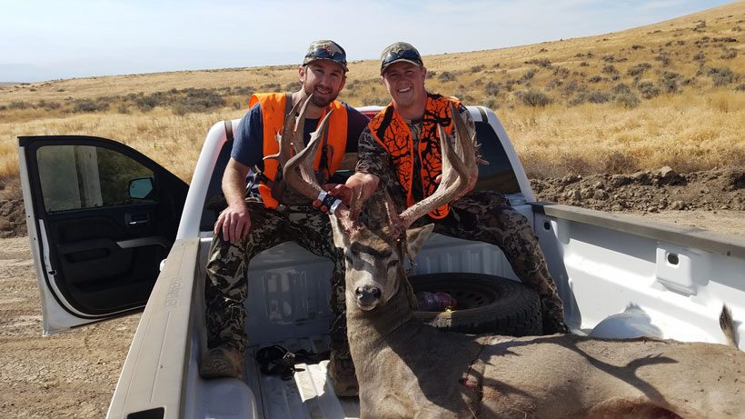 Jake and Trevor with the buck