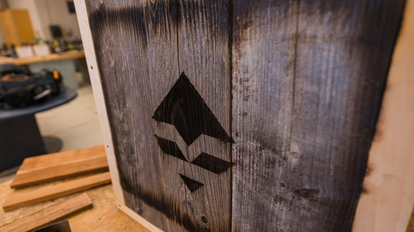 Burned in goHUNT logo in barn wood