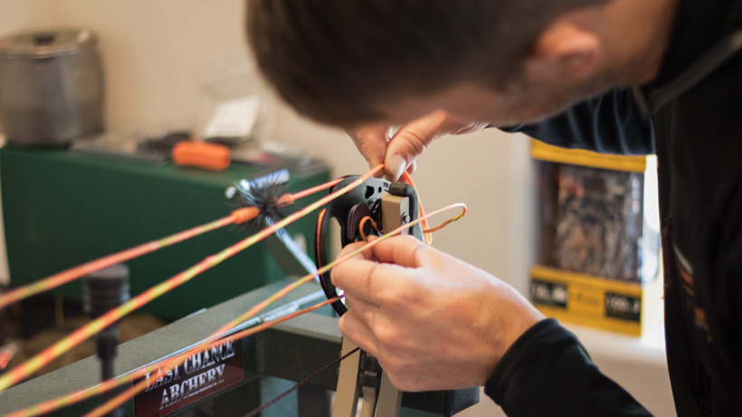 Carefully changing the string on a bow