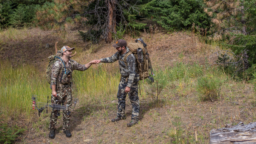 Celebrating an elk hunt with a friend