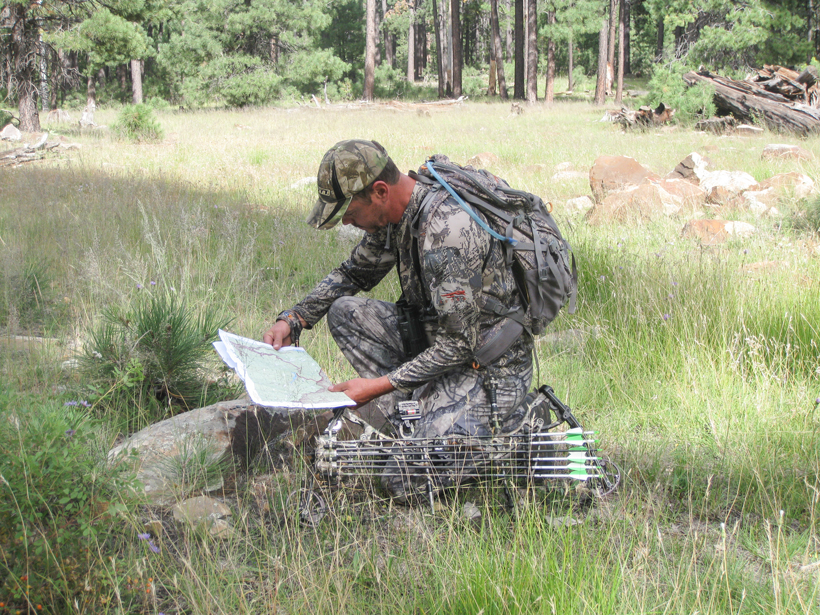 Checking out a map on an elk hunt
