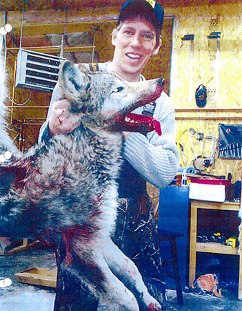 Clay Thomas with one of the wolves he shot