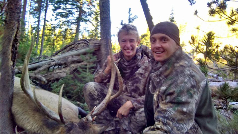 Clint Como and his son with a bull elk