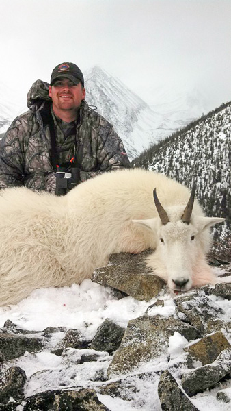 Cody Phillips with his Montana mountain goat
