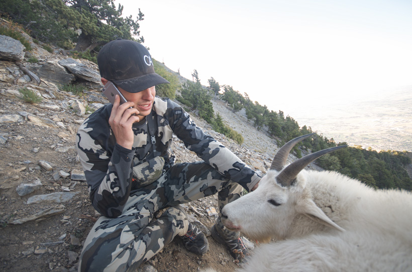 Cody Wetmore calling friends after taking a Utah mountain goat