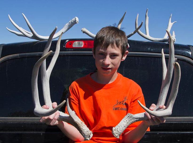 Colton with mule deer shed antlers