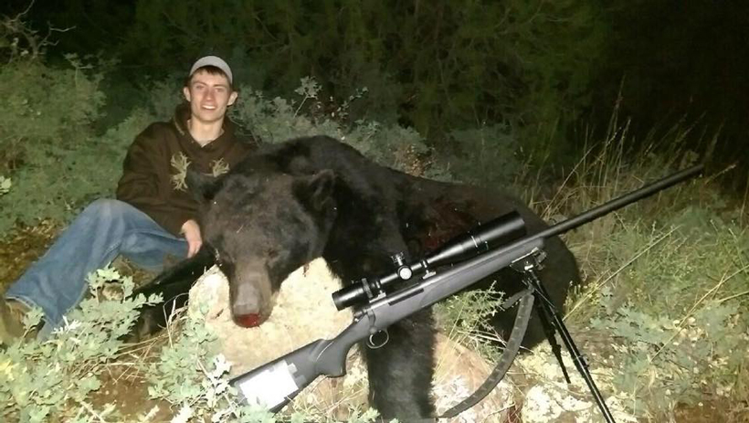 Colton with his Arizona black bear