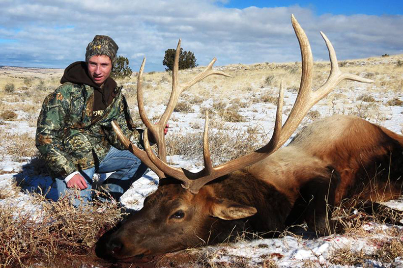 Colton with his first bull elk in Arizona