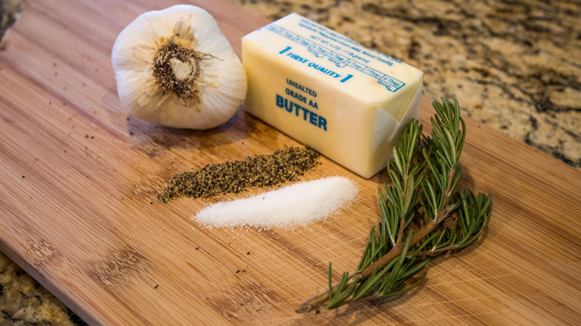 Combining butter garlic and rosemary for elk roast