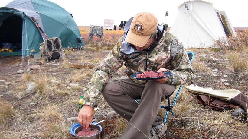 Cooking fresh Alaska caribou at camp