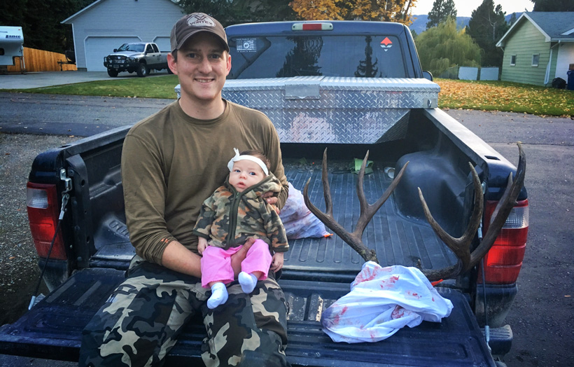 Dave Barnett and newborn daughter with a Montana mule deer