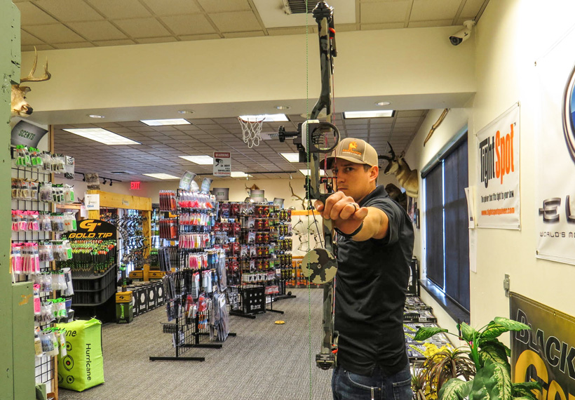 Dave Barnett checking second axis on a bow sight