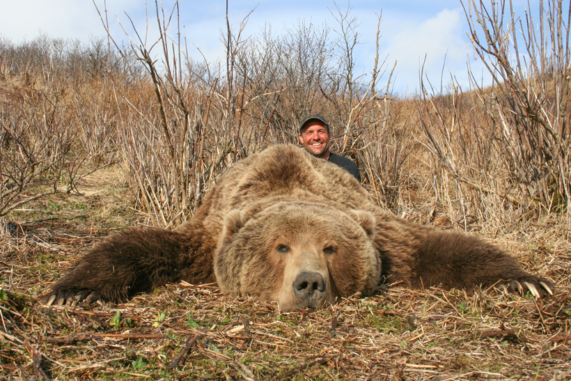 Dave Loescher with his brown bear laid out