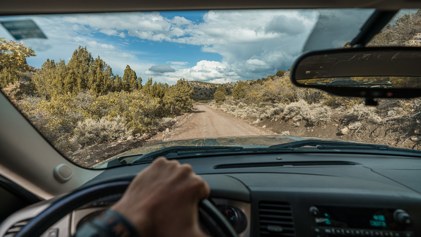 Driving down roads to summer scout for mule deer