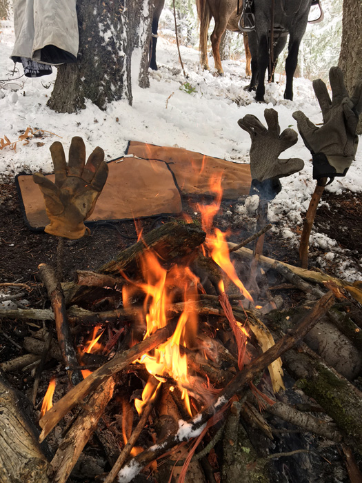 Drying gloves by a fire