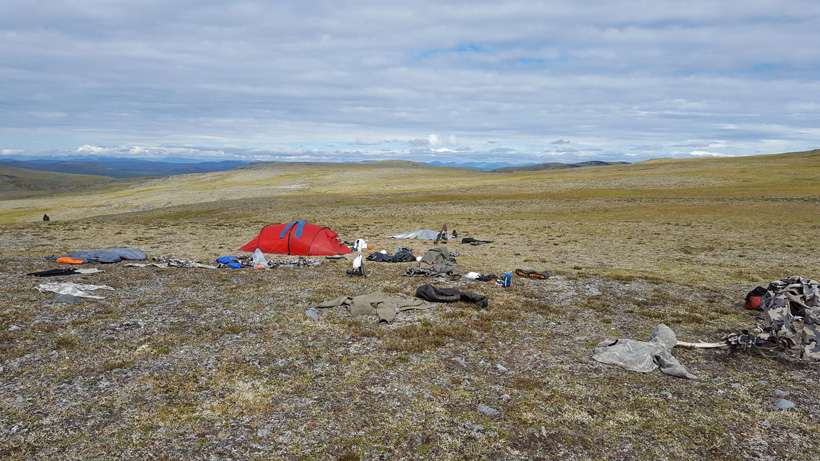 Drying out hunting gear in the tundra