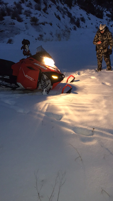 Early morning snowmobile scouting for mountain lion