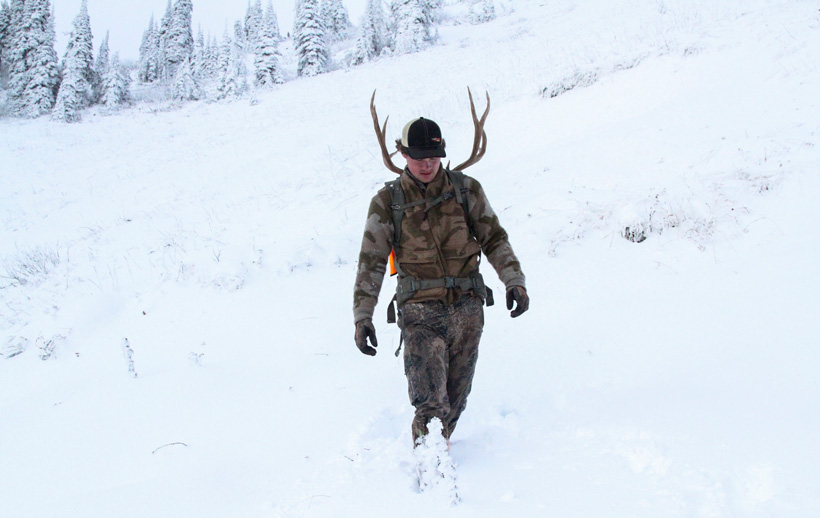 Easton Enott packing out his high country Montana mule deer