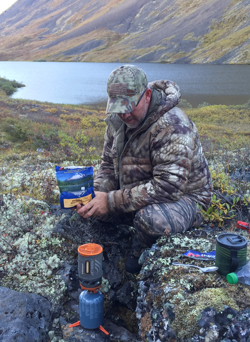 Eating freeze dried meal while hunting sheep
