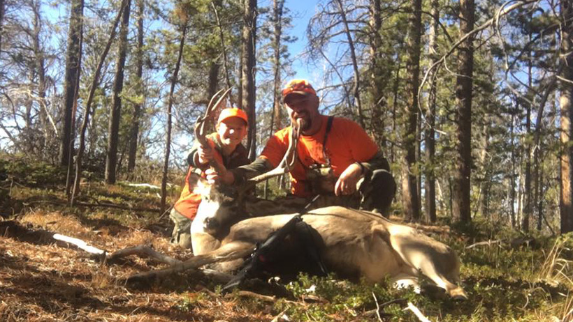 Father and son with a Colorado mule deer buck