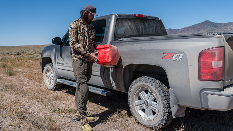 Filling up gas in truck while antelope hunting