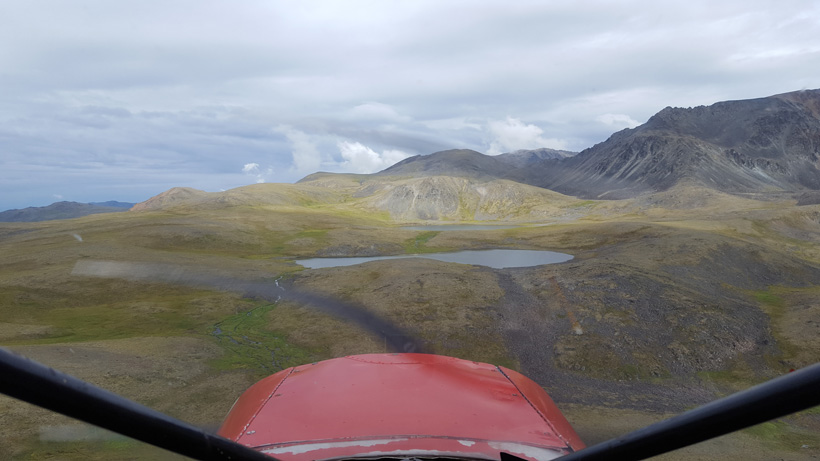Flying into the mountains of Alaska