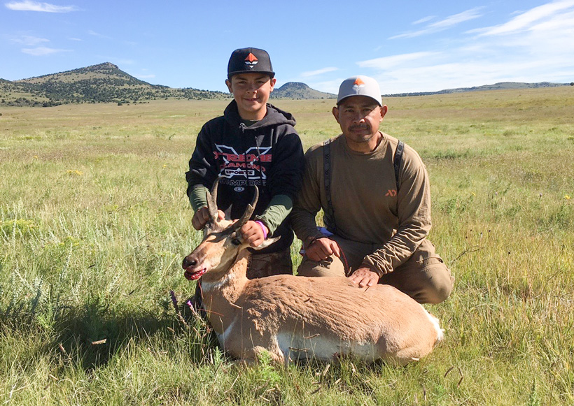Gannon and his dad with their New Mexico antelope buck