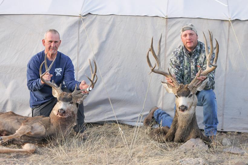 Gayle and Bryant with their mule deer bucks