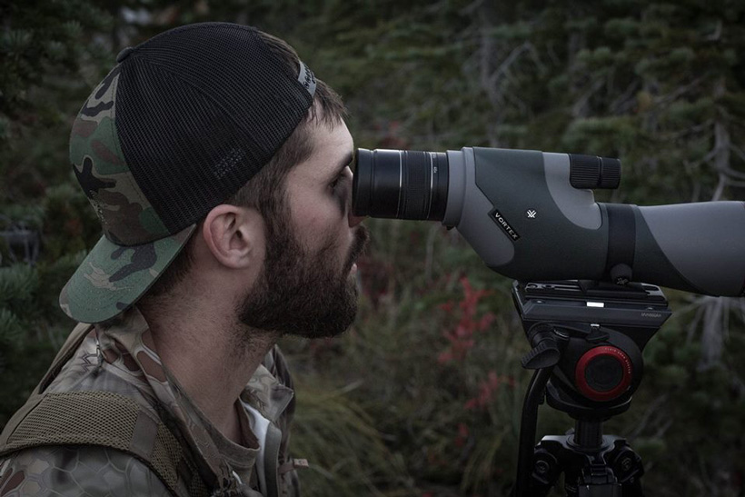 Glassing with a spotting scope for elk